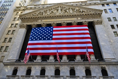 New York stock exchange facade with USA flags